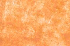 abstrakt bakgrundsorange Yttersidan av betong eller metall Royaltyfri Bild