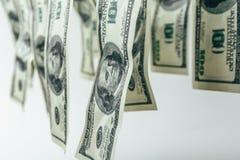 abstrakt bakgrundspengar US dollarsedlar på vit bakgrund Arkivbild