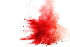 Abstrakt begrepp av den röda pulverexplosionen på vit bakgrund Rött pulver splatted isolat Kulört moln Kulört damm exploderar Mål arkivfoton