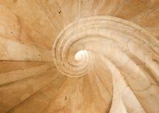Abstrakt begrepp av en spiraltrappuppgång som göras av ljus sandsten Fotografering för Bildbyråer
