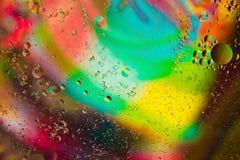 Abstrakt begrepp bevattnar färgar bakgrund Arkivfoton