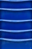 Abstrakt begrepp: Blått staplade stolar Royaltyfria Bilder