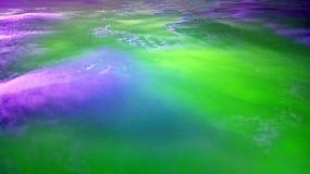 Abstrakt begrepp fördunklar i gröna lilor Royaltyfri Fotografi