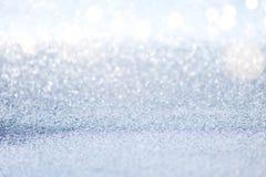 Abstrakt begrepp försilvrar blänker bokehljus med mjuk ljus bakgrund royaltyfri bild