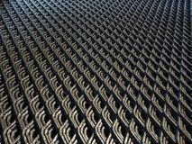 Abstrakt begrepp fodrar och den industriella metallingreppsmodellen Arkivfoto
