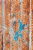 Abstrakt begrepp korroderade rostigt konstnärligt för färgrikt grungebakgrundsjärn Royaltyfria Bilder