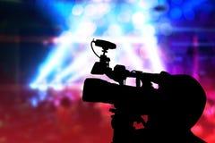 Abstrakt begrepp med konturn av fotografvideoen i konsert Arkivfoto
