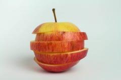 Abstrakt begrepp skivat äpple på vita bakgrunder fotografering för bildbyråer