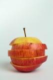 Abstrakt begrepp skivat äpple på vita bakgrunder royaltyfria foton