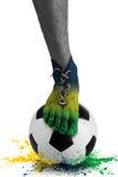 Abstrakt begrepp skor fotbollspelarens fot, färger plaskar Fotografering för Bildbyråer