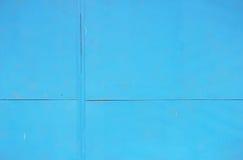 Abstrakt begrepp specificerad textur för bakgrund för blåttmetallväggen av arket målade med målarfärg Royaltyfri Bild