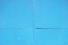 Abstrakt begrepp specificerad textur för bakgrund för blåttmetallväggen av arket målade med målarfärg Royaltyfri Foto