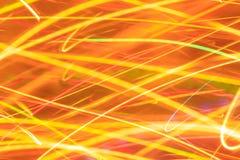 Abstrakt begrepplinjer av apelsinen, guling och röda ljus Arkivbild