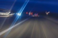 Abstrakt begreppskott på långa exponeringstrafikbilar Arkivbilder