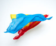 Abstrakt begreppstycken av det blåa och röda tygflyget Arkivfoton
