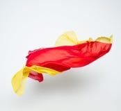 Abstrakt begreppstycken av det röda och gula tygflyget Royaltyfria Bilder