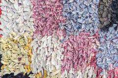 Abstrakt begrepptexturer med fyrkanter från färgtrasor Arkivbild