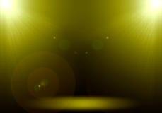 Abstrakt bild av den guld- strålkastaren för belysningsignalljus 2 på golvet s Arkivfoton