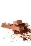 Abstrakt bild av mörk choklad på vit bakgrund Arkivbilder