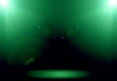 Abstrakt bild av strålkastaren för signalljus 2 för grön belysning på golvet Arkivfoton