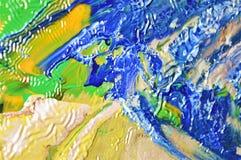 Abstrakt bild med färgpulver i guling- och blåtttoner Royaltyfria Foton