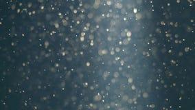 Abstrakt blå bakgrund med härliga guld- flimrande partiklar Undervattens- bubblor i flöde med bokeh Royaltyfri Bild
