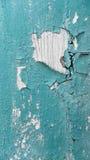 Abstrakt blå bakgrund med sprickor på målarfärgen Arkivfoto