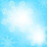 Abstrakt blå julsnöflingabakgrund Royaltyfri Foto