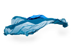 Abstrakt blått tyg i rörelse Fotografering för Bildbyråer