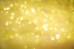 Abstrakt bokeh av guld- blänker Royaltyfria Foton