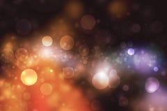 Abstrakt Bokeh ljus på mörk bakgrund arkivfoto