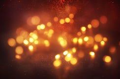 abstrakt bokehbakgrund av den guld- ljusbristningen som göras från bokehrörelse Royaltyfri Foto