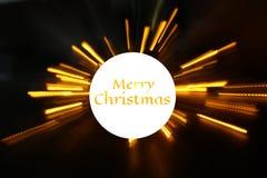 abstrakt bokehbakgrund av guld- ljus brast med GLAD JUL för text Royaltyfri Fotografi