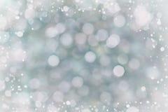 Abstrakt bokehbakgrund för din design, suddiga ljus med snöeffekt Royaltyfri Bild