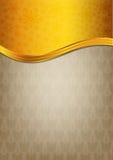 Abstrakt brun beröm som är pappers- med guld- ribbo Royaltyfri Fotografi