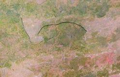 abstrakt bruna färger mönsan den rödaktiga stenyttersidatravertinen Arkivbilder
