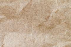 Abstrakt brunt återanvänder skrynkligt papper för bakgrund: veck av Fotografering för Bildbyråer