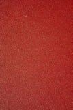 Abstrakt Closeup för ytterlighet av det röda arket av sandpapper Royaltyfri Foto