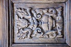 Abstrakt dörrträ i det bruna Spanienet Arkivfoton
