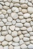 Abstrakt del av ett gammalt staket av stenen Arkivbilder