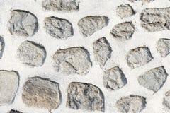 Abstrakt del av ett gammalt staket av stenen Royaltyfri Foto