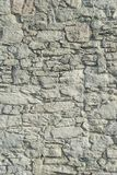Abstrakt del av ett gammalt staket av stenen Royaltyfri Bild