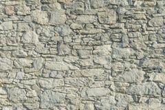 Abstrakt del av ett gammalt staket av stenen Royaltyfri Fotografi