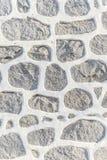 Abstrakt del av ett gammalt staket av stenen Fotografering för Bildbyråer