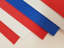 abstrakt design med ark av skummande i röda, vit- och blåttfärger, texturerad bakgrund Arkivfoton