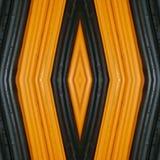 abstrakt design med stycken av plasticinestänger i färger apelsin och svart, bakgrund och textur Arkivfoto
