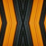 abstrakt design med stycken av plasticinestänger i färger apelsin och svart, bakgrund och textur Arkivbilder