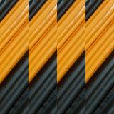 abstrakt design med stycken av plasticinestänger i färger apelsin och svart, bakgrund och textur Royaltyfri Fotografi