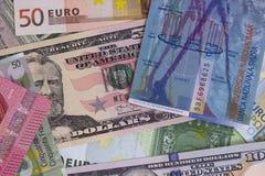 Abstrakt dollareuro- och schweizisk francbakgrund royaltyfri fotografi