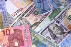 Abstrakt dollareuro- och schweizisk francbakgrund arkivfoton